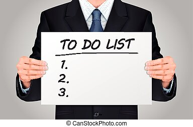 businessman holding to do list - close-up look at...