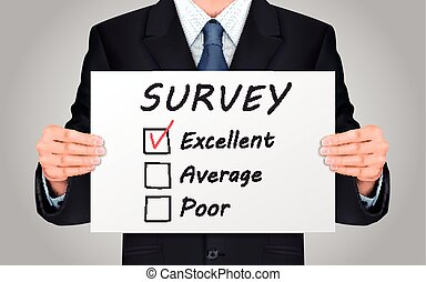 businessman holding quality survey poster