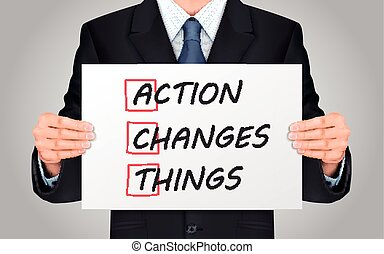 businessman holding Action Changes Things poster - close-up...