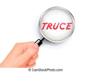 truce showing through magnifying glass held by hand