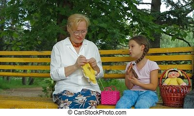 Family Talk In A Park - Grandmother and granddaughter...