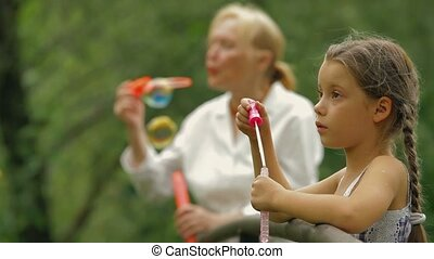 Family Leisure - Grandmother and granddaughter spending time...