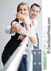 romantic happpy couple on balcony - romantic happy couple...