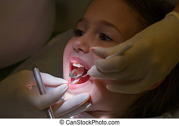 Little girl at paediatric dentists office - Little girl at...