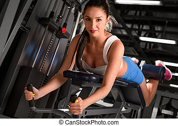 Sexy sporty woman training in the gym