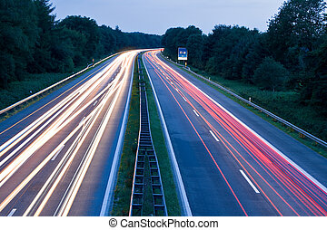 Tail Lights - Cars speeding on highway