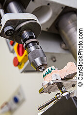 production dentures drill in action - Dental laboratory,...