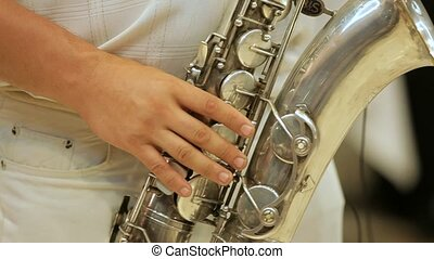 Saxophonist And His Instrument - Saxophonist plays on his...