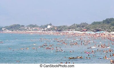 summer sea with lot of bathers