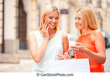 I want you to have it Happy mature woman holding shopping...