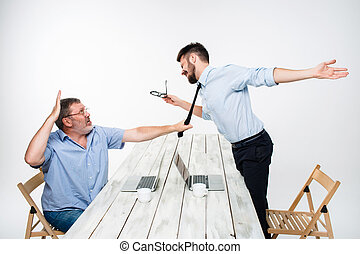 Business conflict. The two men expressing negativity while...