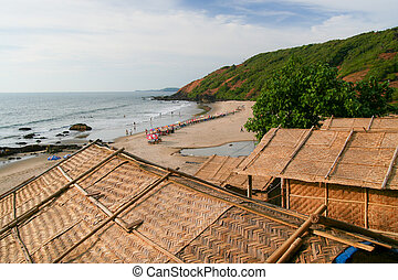 Straw hut roofs and beach view goa india - Straw hut roofs...