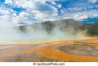 Grand Prismatic Spring - Deatiled photo of steaming Grand...