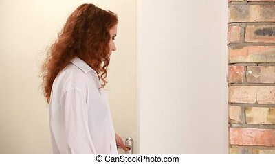 Girl In Grief - A beautiful red-haired girl in a white shirt...