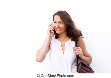 Attractive woman with bag using cell phone