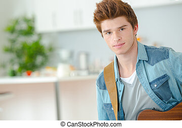 Teenager learning to play the guitar