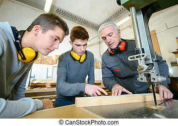 Male students in a woodwork class