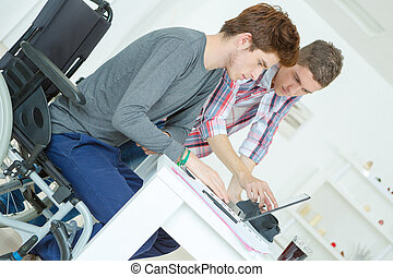 Two male teenagers studying at home