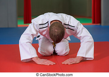 Martial artist bowing before a match