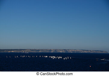 many sailboats and blue sea - many white sailboats with...