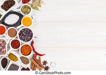 Various spices on white wooden background Top view with copy...