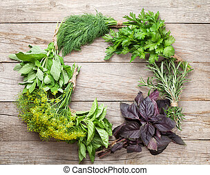 Fresh garden herbs on wooden table Top view with copy space