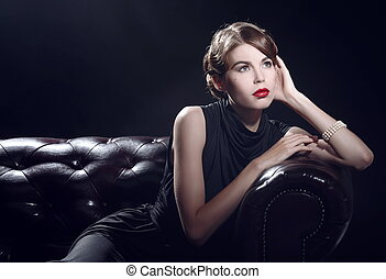 Young beautiful woman in black dress