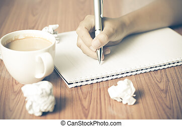 hand writing with pen on notebook - woman hand writing with...