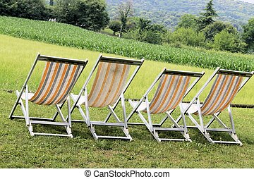 deckchair with rural views in Italy