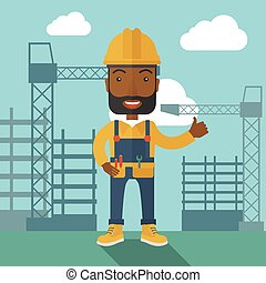 Black man standing infront of construction crane tower - A...