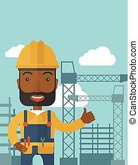 Black man standing infront of construction crane tower.