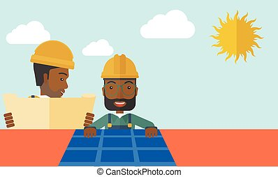 African man putting a solar panel on the roof. - An african...