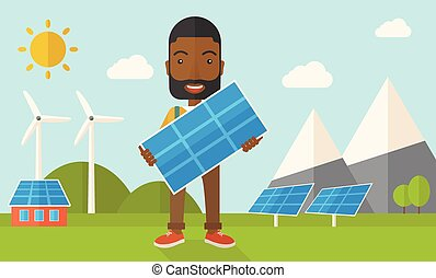African man holding a solar panel. - A happy african young...