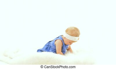 Little Girl On White Background - Little girl sits on a...