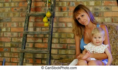 Woman Is Holding Her Baby - Beautiful woman holding her baby...
