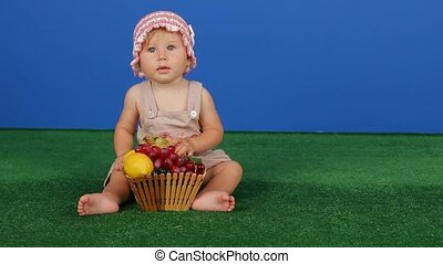 Girl Holding Grapes On A Blue Background - Charming little...