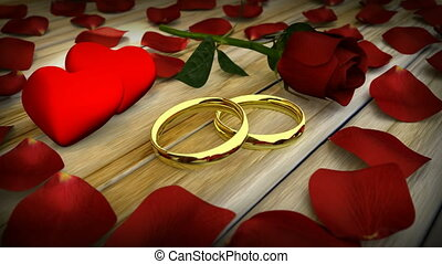Two golden wedding rings and red rose with petals on wooden...