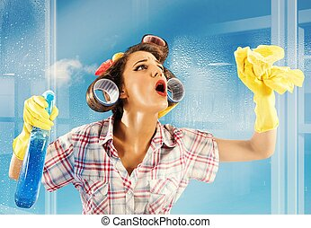 Housewife clean glass - Pin-up housewife breathes on a clean...