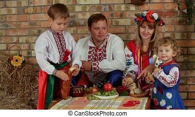 Ukrainian Family Dinner - A large family dressed in...