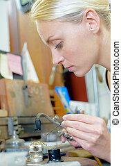 Jeweler repairing chain