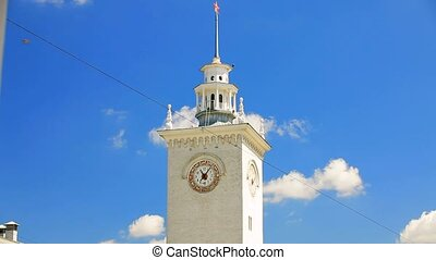 Clock Tower At Railway Station on Blue Sky Background,...