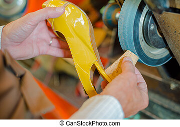 Grinding heel of a shoe
