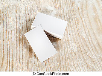Business cards - Blank business cards on light wooden...