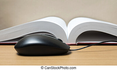 book and computer mouse