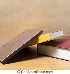 stack of book on wood background