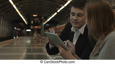 Couple with Tablet PC Waiting for Tube Train - Young couple...