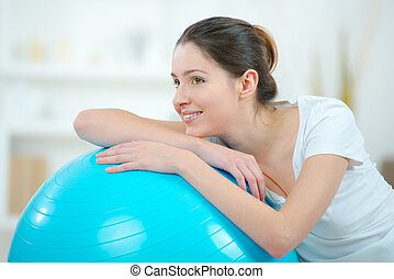 woman resting on a gym ball