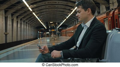 Businessman Waiting fot the Tube Train