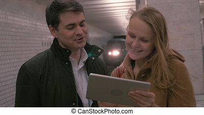Firends with Tablet PC at Metro Station