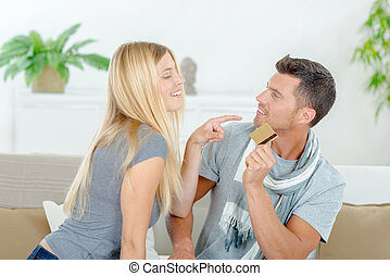 Couple fighting over possession of credit card